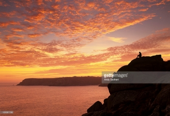 sillouette figure on clifftop